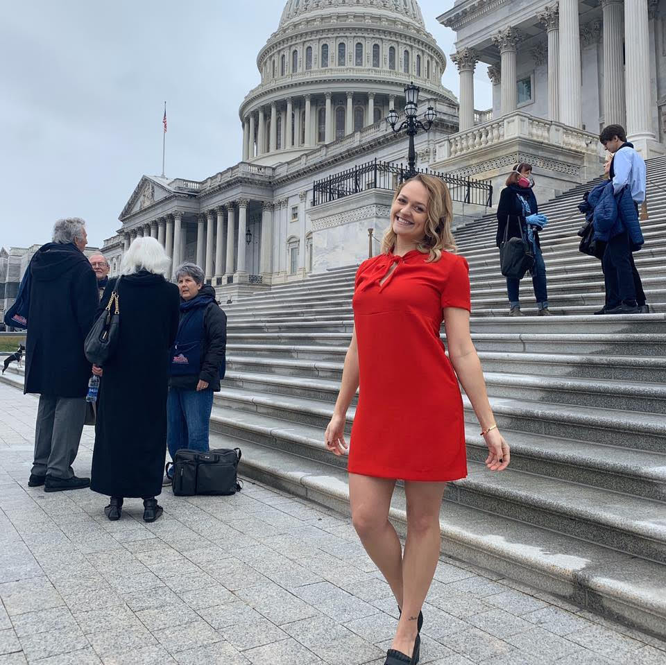 Taylor wearing red dress outside capitol building Washington DC