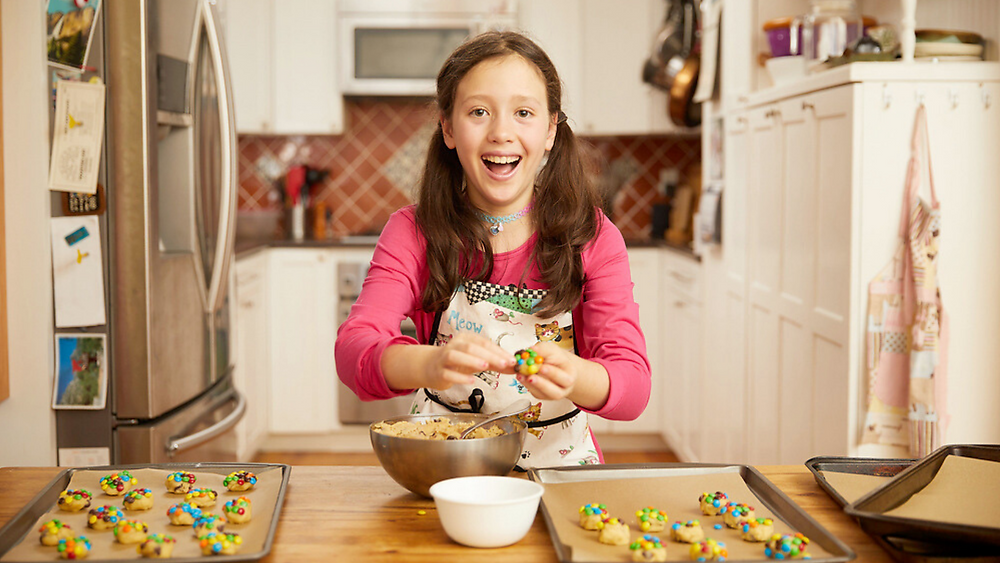 Dana pictured baking cookies