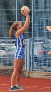 Zoe playing netball
