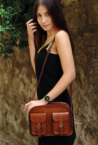 young-woman-leather-bag-dust-326x483.jpg