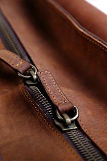 dust-zip-detail-leather-bag.jpg