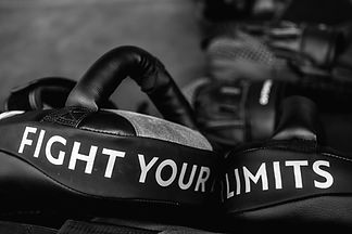 Close up of FIGHT YOUR LIMITS word on bl