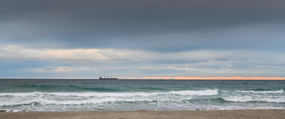 Ship at sea off the coast of Mount Maunganui