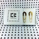 Gold Parity drop earrings in branded box