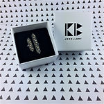 Silver asymmetrical Blaise ring in branded box