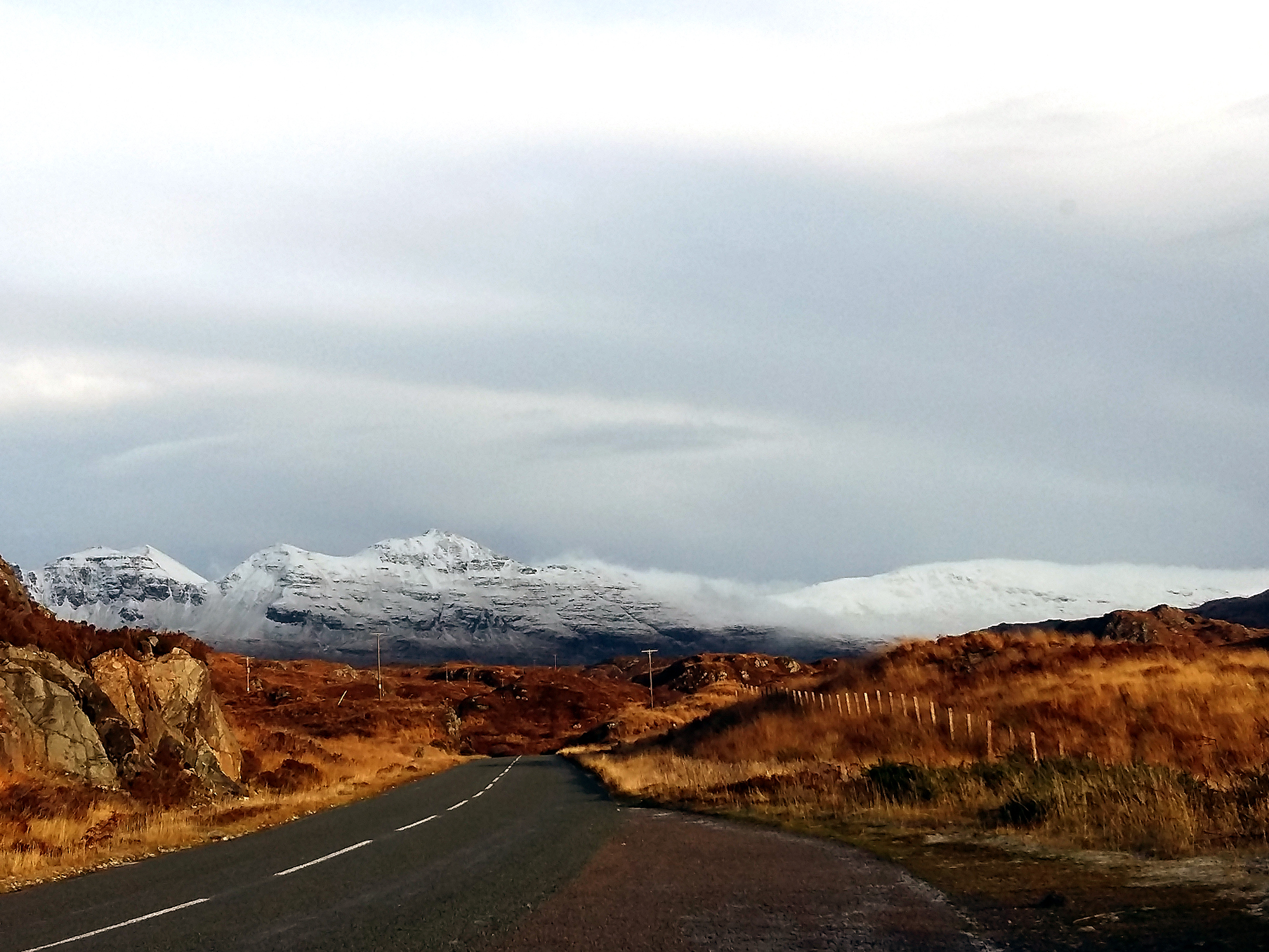 NC500 Roadtour view with snowed mountain