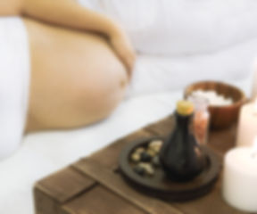 Young pregnant woman have massage treatm