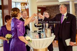 Wedding_E&J_Groom_Bride_Bridesmaid_Groomsman_Cheers_Champagne_Philip_Murray_Photography_Dublin