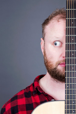 Fred Cooke Comedian Guitar Grey Background Red Shirt Half Face Portrait Philip Murray Photography Du