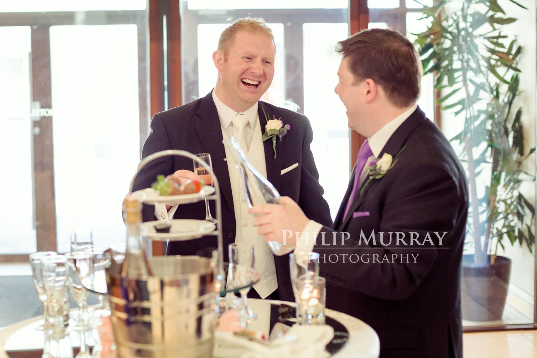 Wedding_E&J_Groom_Bride_Groomsman_Cheers_Champagne_Philip_Murray_Photography_Dublin