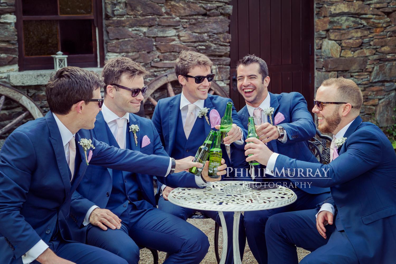 Wedding_A&F_Couple_Bride_Groom_Groomsmen_Cheers_Bottles_Beer_Celebrate_Philip_Murray_Photography
