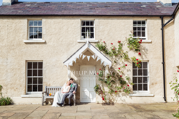 Wedding_S&D_Garden_Flowers_Bouqet_Bride_Groom_Sitting_Bench_House_Philip_Murray_Photography_Dublin
