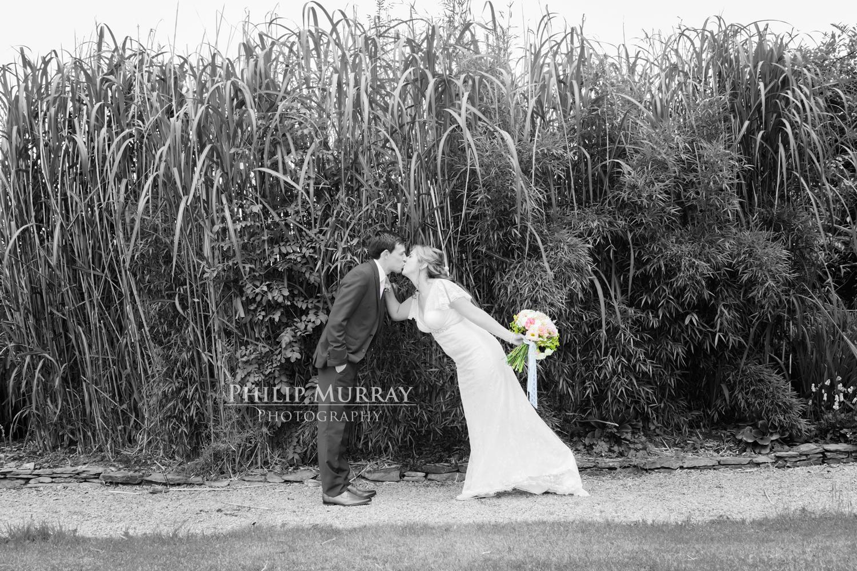 Wedding_A&F_Couple_Bride_Groom_Kiss_Colour_Mix_Tall_Plants_Garden_Philip_Murray_Photography