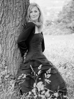 Portrait Woman Leaning On Tree Black