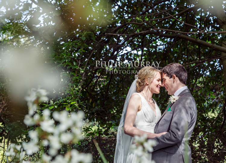 Wedding_S&D_Garden_Flowers_Bride_Groom_Smiling_Philip_Murray_Photography_Dublin