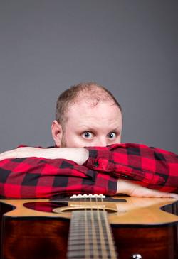 Fred Cooke Man Comedian Guitar Grey