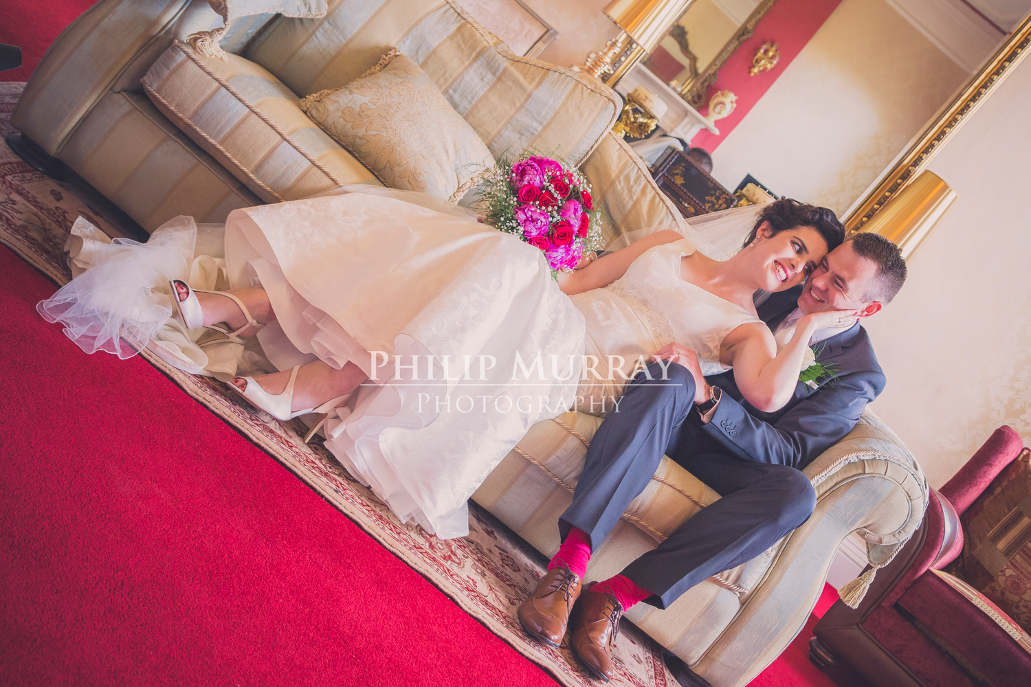 Wedding_A&S_Couple_Bride_Groom_Siting_Couch_Laughing_Philip_Murray_Photography_Dublin