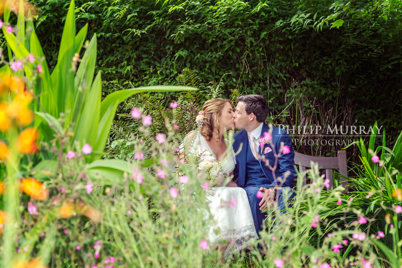 Wedding_A&F_Couple_Bride_Groom_Kiss_Colour__Flowers_Plants_Garden_Philip_Murray_Photography