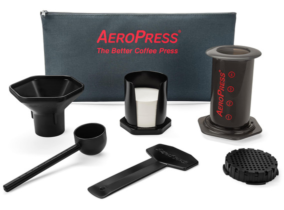 AeroPress and accessories next to tote b