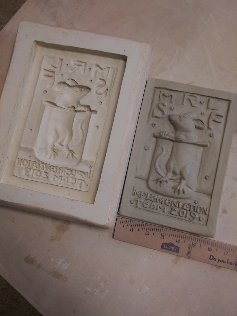 Press mold (negative) and tile