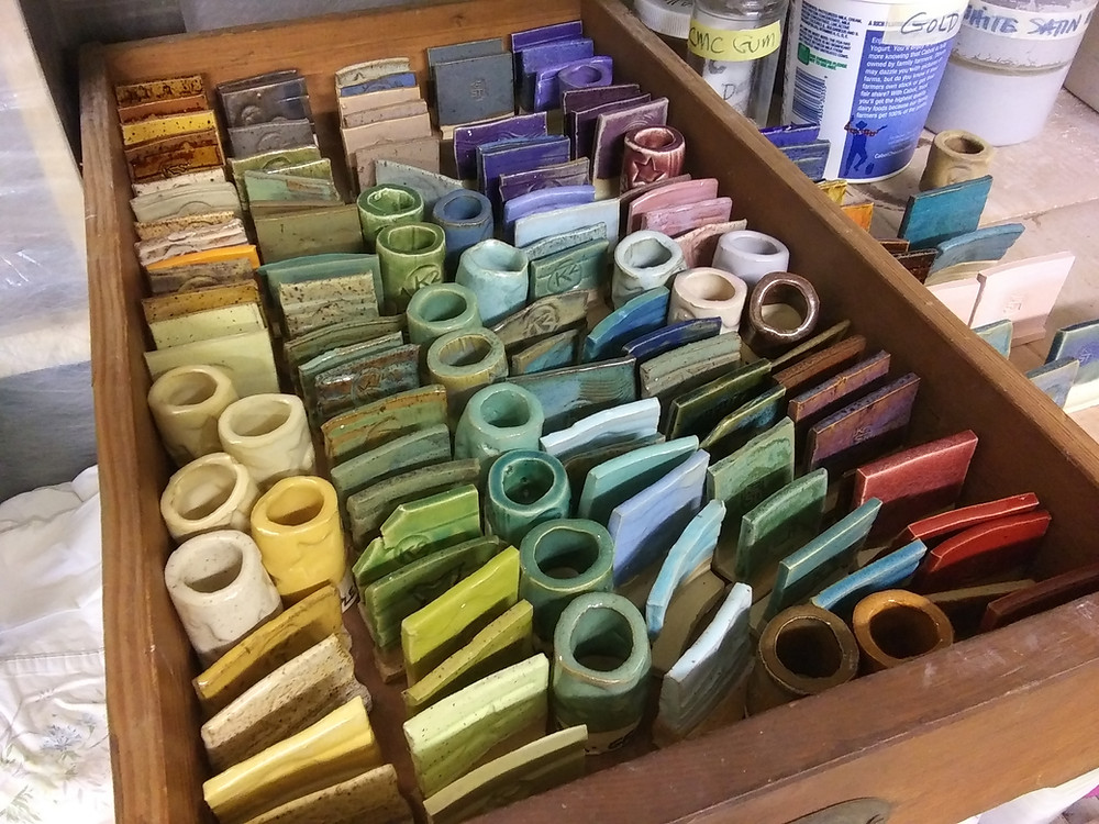 """Nearly 100 or more glaze colors on fired 2"""" x 2"""" ceramic test tiles ."""