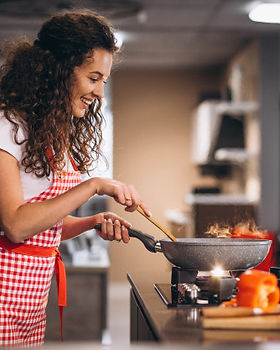 woman-chef-cooking-vegetables-pan_1303-2
