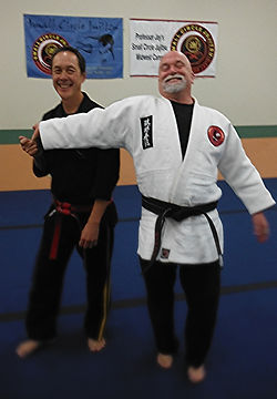 Professor Leon Jay and Jerry Dozier with small circle Jujitsu