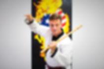 Master Clark with sticks