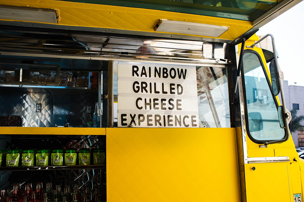 Food truck with grilled cheese sign.