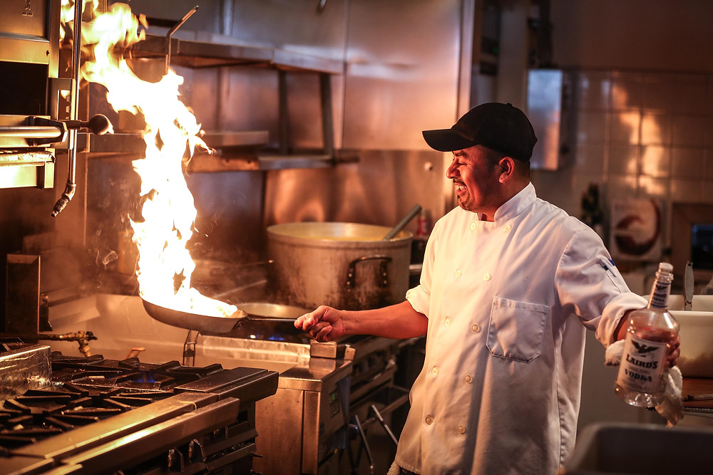 Line cook or head chef in the restaurant kitchen doing their job.