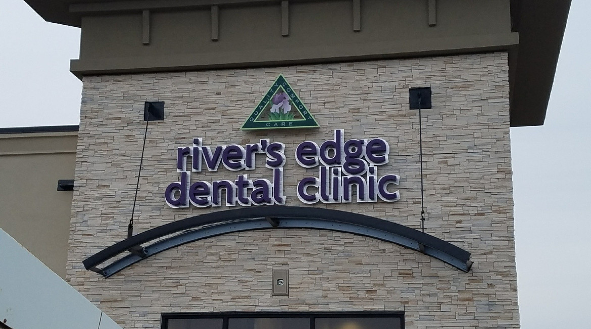 Halo lit Channel Letters with Custom LED lit Acrylic logo for River's Edge Dental Clinic