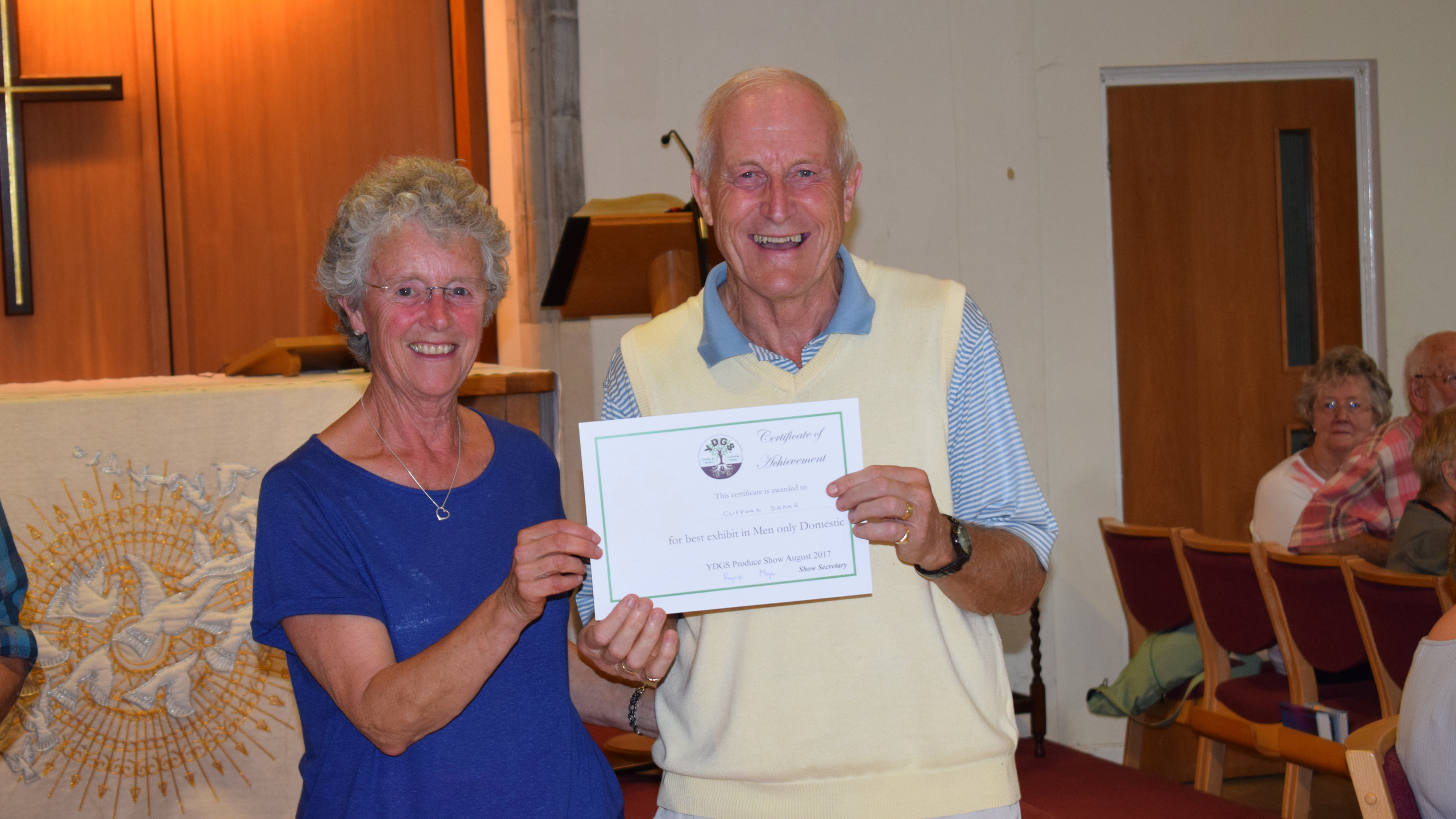 Cliff receives certificate from Cherie