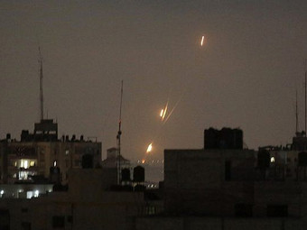 Dozens of rockets and shells fired into Israel overnight, house hit...
