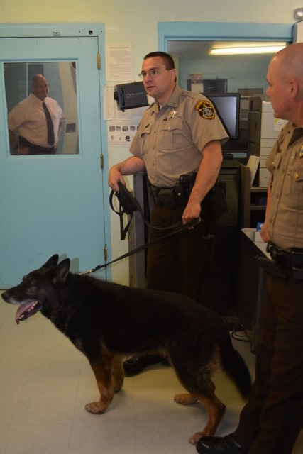 Sgt. Bean and retired K9 Diesel helping with a search of the jail._edited