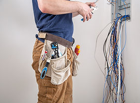 electrician-builder-work-examines-cable-