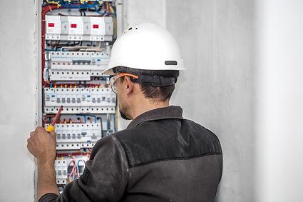 man-an-electrical-technician-working-in-