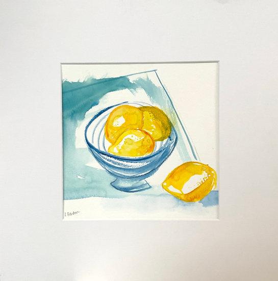 Four lemons and a stripey bowl.
