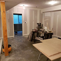 Drywall is hung, ceiling is textured, tr