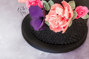 Black Textured Cake with Bright Flowers