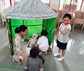 Setting up the doll house1.jpg