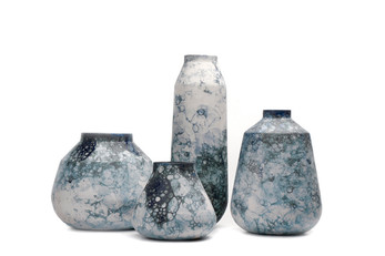A Collection Of Vases With A Playful Bubble Pattern