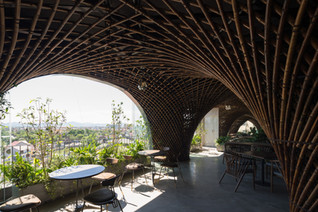 Vo Trong Nghia creates Nocenco cafe with swirling bamboo ceiling