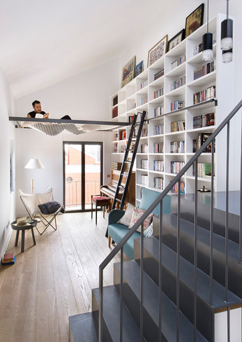 A suspended net was designed to be a fun place to hang out and read a book