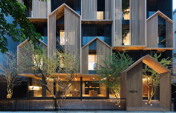 OCTANE plays with the archetypal house shape on the facade of HACHI SERVICED APARTMENT in Bangkok