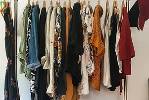 clothes%2520hanged%2520on%2520brown%2520wooden%2520cabinet_edited_edited.jpg