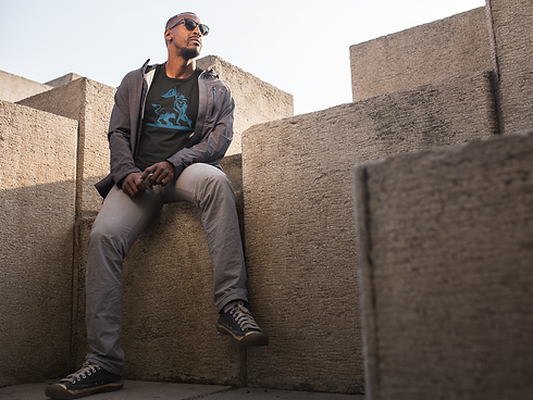 black-man-sitting-on-a-modern-concrete-s