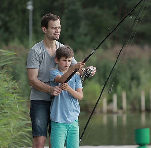 teenage-boy-learning-fish-fathers-footag