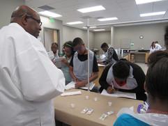 Mr. Davis demonstrating field test procedures