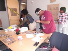 Students marking evidence in crime scene