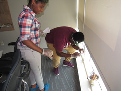 Students collecting evidence from crime scene